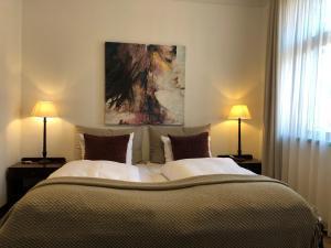 En eller flere senge i et værelse på Park Hotel