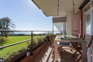 A balcony or terrace at Gavamar Castelldefels Beachfront Apartment- Direct access to the beach