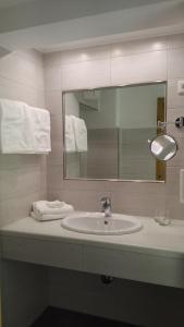 Ein Badezimmer in der Unterkunft Hotel Löffler