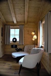 Ein Sitzbereich in der Unterkunft Chalet Watzmann