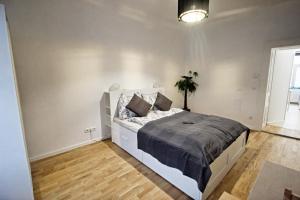 Ein Bett oder Betten in einem Zimmer der Unterkunft Vienna Vision Apartment inkl. Netflix!
