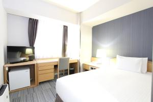 A bed or beds in a room at SureStay Plus Hotel by Best Western Shin-Osaka