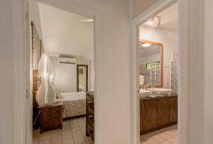 A bathroom at Crown Beach Resort & Spa