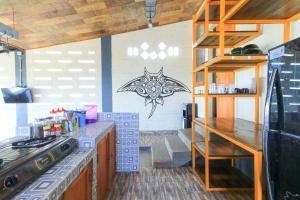 A kitchen or kitchenette at Hostel Bukit Sangcure