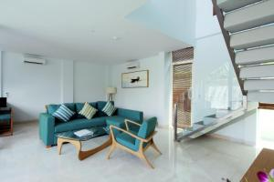 A seating area at AQ-VA Hotel & Villas Seminyak