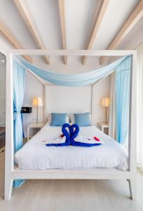 A bed or beds in a room at Lindos View Hotel