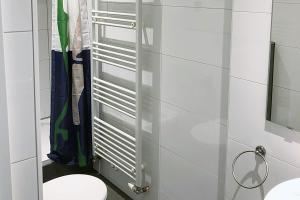 A bathroom at cosy three room apartment with flatscreen TV
