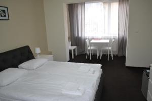 Ліжко або ліжка в номері Рахів готель та апартаменти
