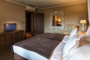 Postel nebo postele na pokoji v ubytování Park Hotel Popovicky