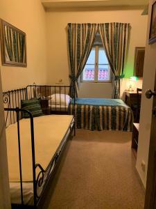 Postel nebo postele na pokoji v ubytování U Schnellu