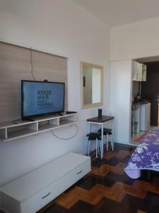 A television and/or entertainment centre at Paraiso Beira Mar