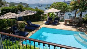 A view of the pool at Pousada Casa Búzios or nearby