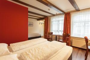 Un ou plusieurs lits dans un hébergement de l'établissement A-Train Hotel