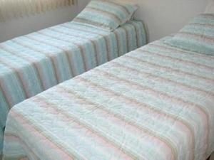 A bed or beds in a room at Flats Service Bueno