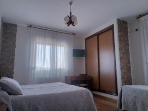 Tempat tidur dalam kamar di Hotel Arume