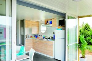 A kitchen or kitchenette at Camping Figurotta