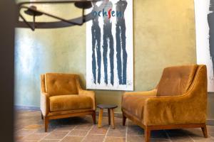 Ein Sitzbereich in der Unterkunft Boutique Hotel OchSen
