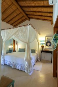 Cama ou camas em um quarto em Etnia Casa Hotel