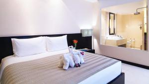 Voodi või voodid majutusasutuse Apsara Beachfront Resort & Villa toas