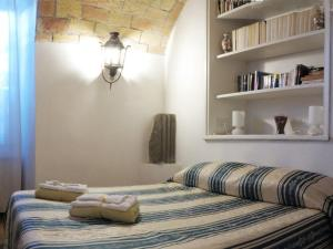 A bed or beds in a room at Villino Corbelli B&B