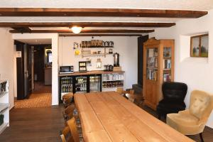 The lounge or bar area at Alps Hostel