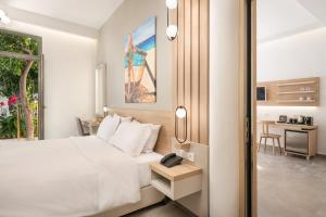 A bed or beds in a room at Epavli Boutique Hotel