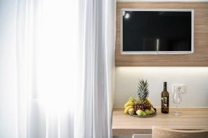 A television and/or entertainment centre at Epavli Boutique Hotel
