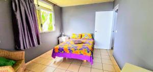 Cama ou camas em um quarto em MOOREA - Fare Taina Iti