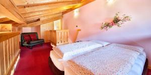 Postel nebo postele na pokoji v ubytování Appartamenti Duc De Rohan