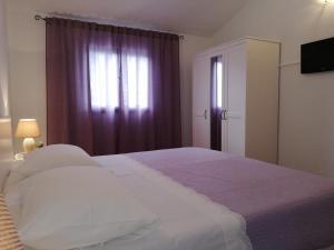 Letto o letti in una camera di Apartment Pečarević - a holiday with a stunning view