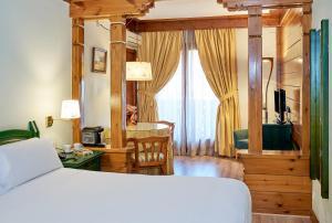 Cama o camas de una habitación en Hotel Grèvol Spa
