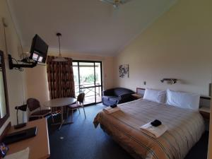 A bed or beds in a room at Karri Forest Motel