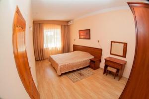 Кровать или кровати в номере Санаторно-курортный комплекс «ДиЛуч»