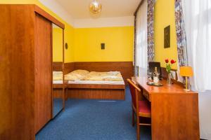 Postel nebo postele na pokoji v ubytování Hotel Morava