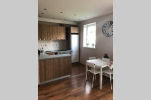 A kitchen or kitchenette at Prestige 1-bedroom apartment close to downtown Riga