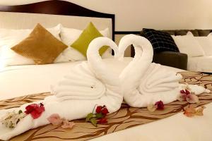 Dot Hotel Yanbaru - 旧Dot Hotel Higashisonにあるベッド