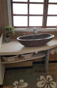 Um banheiro em Tanikai 1