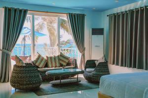 A seating area at Boracay Ocean Club Beach Resort