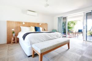 A bed or beds in a room at Orpheus Island Lodge