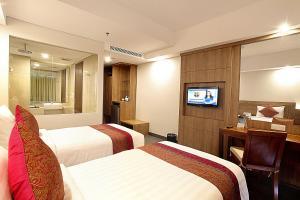 Кровать или кровати в номере Paragon Hotel Seminyak