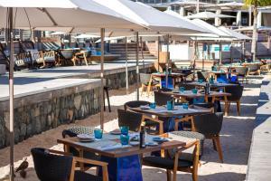 A restaurant or other place to eat at Le Barthélemy Hotel & Spa