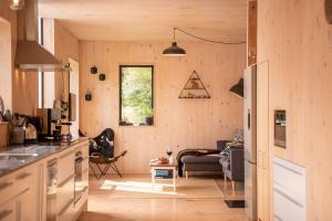 A kitchen or kitchenette at Bellbird Bach - Akaroa Holiday House
