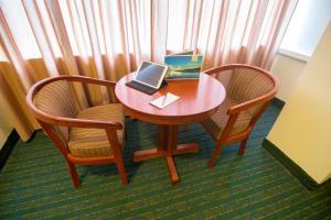 A seating area at El Dorado Classic Hotel