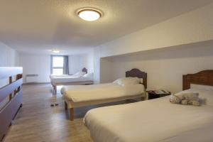 A bed or beds in a room at Les Bergers S3/4p.