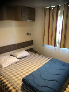 Un ou plusieurs lits dans un hébergement de l'établissement Camping Lou Cabasson
