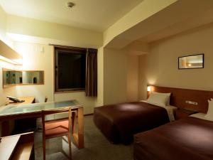 A bed or beds in a room at Candeo Hotels Ueno Park
