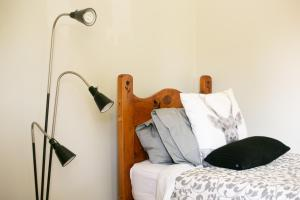 A bed or beds in a room at Grace Cottage
