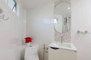 A bathroom at Kata White Villas