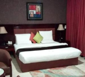 A bed or beds in a room at Crystal Court