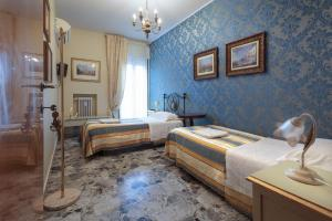Cama ou camas em um quarto em Il Giramondo